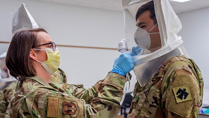 Tech. Sgt. Rebecca Keylon, a bio-environmental engineering technician with the 137th Special Operations Medical Group, Oklahoma Air National Guard, administers a N95 medical mask fit test to Oklahoma Army National Guard Pvt. Connor Boal, a medic with the Oklahoma Army National Guard Medical Detachment, as part of COVID-19 medical response training at the 90th Troop Command Headquarters in Oklahoma City, April 10 - 11. The training, which included presentations by the University of Oklahoma Medical Center and the Oklahoma County Health Department, will prepare Oklahoma Army and Air National Guard medical personnel for potential missions with their civilian counterparts in response to the outbreak of COVID-19 across the state.