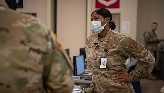 Oklahoma Air National Guard Senior Master Sgt. Scherryl Coulter, a human resources specialist assigned to Joint Force Headquarters - Air Staff, confirms overall numbers and unit assignments of Oklahoma Army and Air National Guardsmen who have been activated by Oklahoma's Governor in response to COVID-19 while working within the Oklahoma Joint Task Force at the Multiagency Coordination Center in Oklahoma City, April 14, 2020. Oklahoma Gov. Kevin Stitt activated 175 additional Oklahoma Army and Air National Guardsmen, April 13, 2020, to aid various missions in support of the state's response to COVID-19.