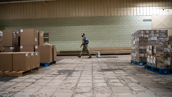 Oklahoma National Guard Spc. James Bates with Headquarters Company, 545th Brigade Engineer Battalion, 45th Infantry Brigade Combat Team, pulls an empty pallet to the front of the Strategic National Stockpile Warehouse as he gathers equipment and medical supplies while assigned to the Stockpile Warehouse in Oklahoma City, April 17, 2020. The nearly 30 Guardsmen assigned to the site — partnered with state agencies to include the Oklahoma Department of Emergency Management, Oklahoma Department of Public Safety, Oklahoma Department of Transportation, Oklahoma Office of Homeland Security and the Oklahoma Department of Corrections — help fulfill, secure and transport the orders to facilities within the 11 identified COVID-19 regional health administration regions throughout Oklahoma as part of the State's whole-of-government response to the pandemic.